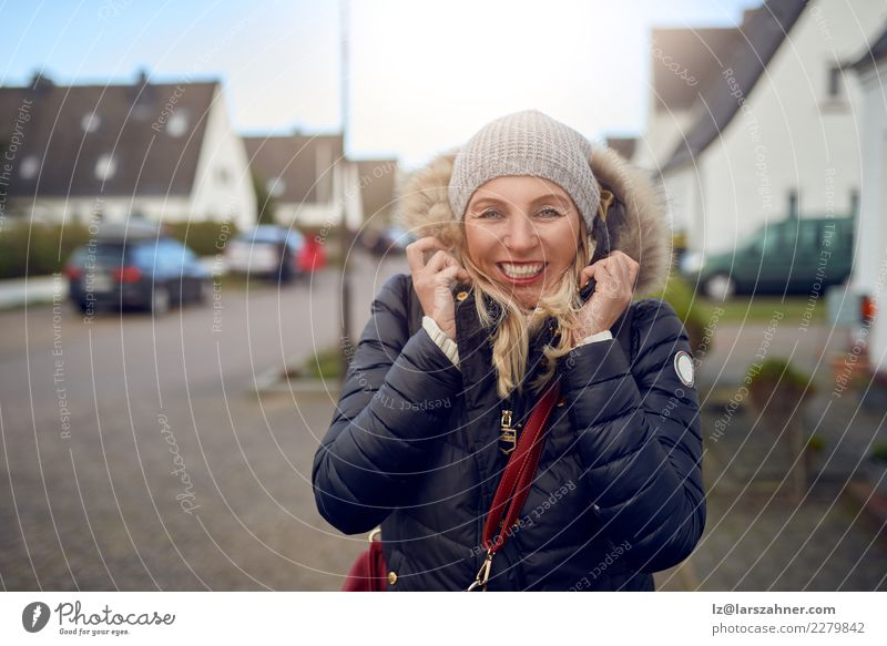 Smiling happy woman outdoors on a cold winter day Woman Beautiful Winter Face Street Adults Autumn Happy Fashion Copy Space Leisure and hobbies Weather