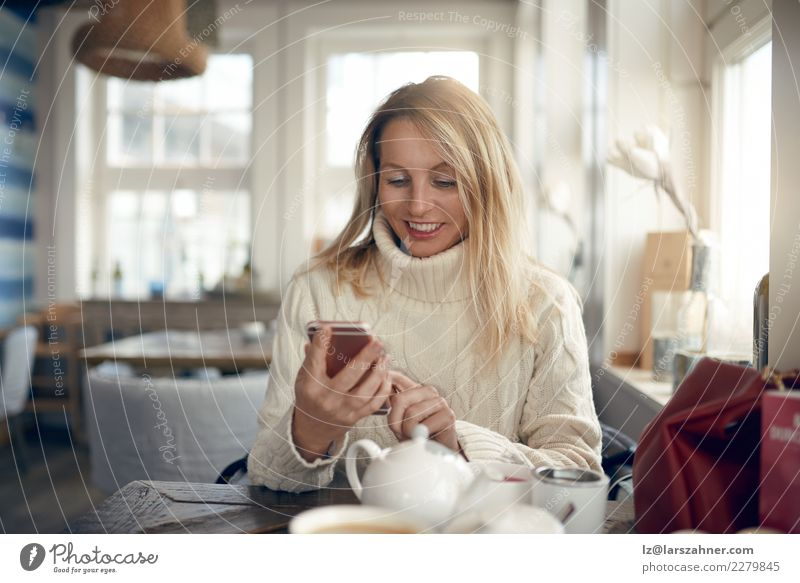 Beautiful woman sending messages on mobile phone Woman Human being Winter Face Adults Lifestyle Autumn Happy Blonde Technology 45 - 60 years Smiling Observe