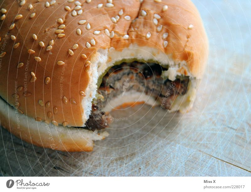burgers Food Meat Roll Nutrition Fast food Delicious Fat Unhealthy Hamburger Cheeseburger Hearty Bite Colour photo Close-up Deserted Neutral Background Appetite
