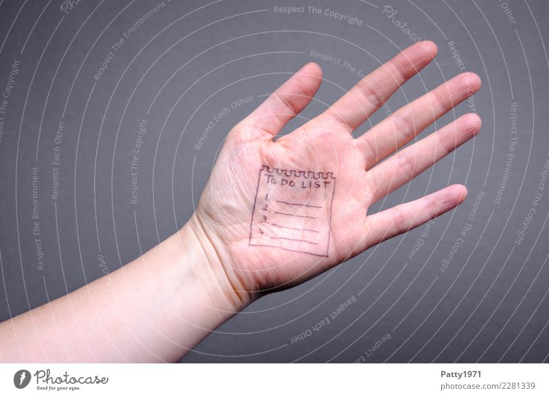 """Detail of a hand. On the palm of the hand a lined note sheet with the inscription """"TO DO LIST"""" is drawn. Human being Hand Palm of the hand 1 Piece of paper"""