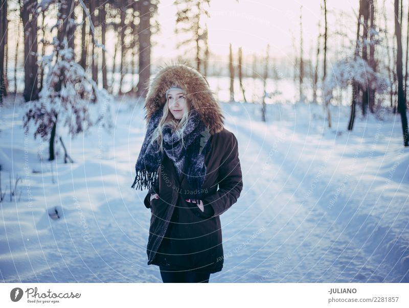 Young woman is taking a walk trough forrest at cold winter Lifestyle Joy Trip Adventure Freedom Winter Snow Winter vacation Human being Feminine