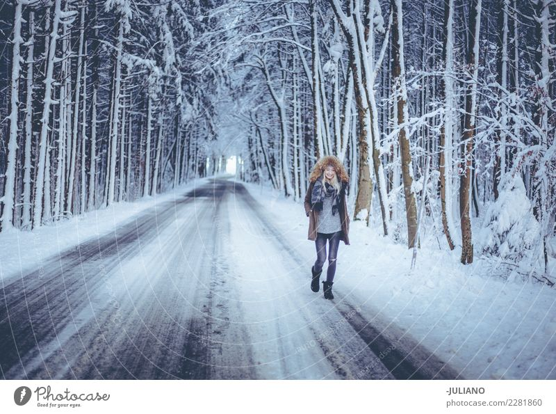Young Woman is walking trough the Forrest in winter Human being Youth (Young adults) Winter Far-off places Dark 18 - 30 years Adults Life Lifestyle Sadness