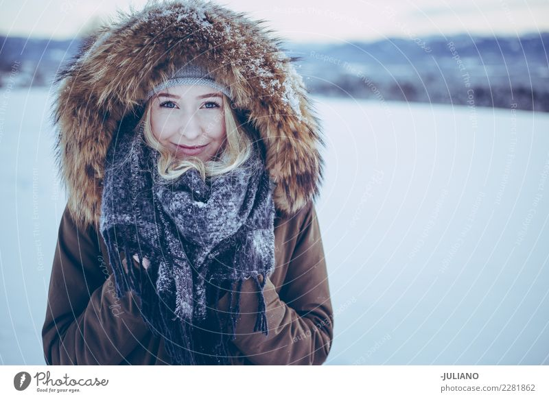 Young smiling girl is hiding her hands from the cold winter Lifestyle Beautiful Winter Snow Winter vacation Human being Feminine 18 - 30 years Woman