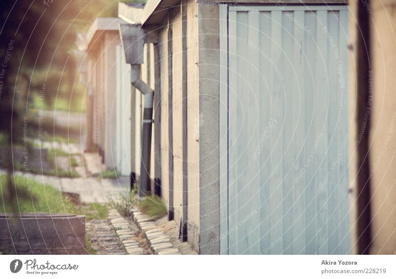 garage way Summer Grass Garage Wall (barrier) Wall (building) Stone Metal Stand Old Sharp-edged Small Near Blue Green Black Safety Protection Orderliness