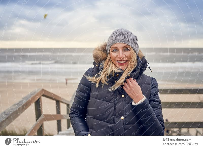 Middle-aged woman braving a cold winter day at the sea Happy Beautiful Face Vacation & Travel Adventure Beach Winter Woman Adults 45 - 60 years Sand Autumn