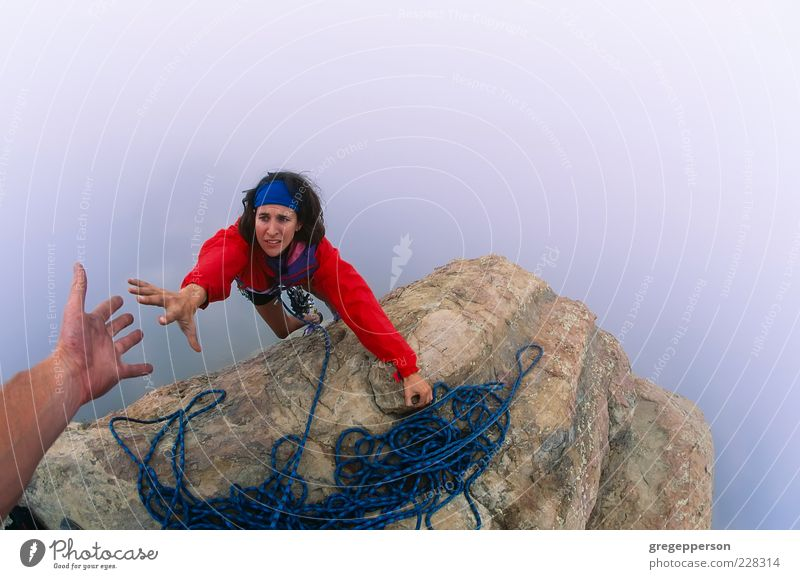 Climber reaching for a helping-hand. Human being Hand Youth (Young adults) Power Adults Success Rope Tall Adventure Climbing Trust Peak Brave Top Athletic