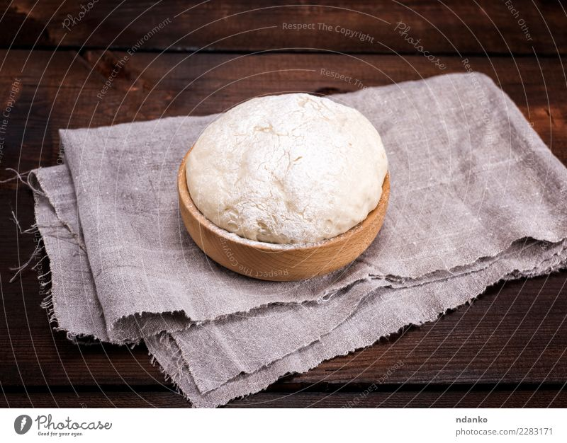 yeast dough in a wooden bowl Dough Baked goods Bread Bowl Table Kitchen Wood Eating Fresh Natural Above Brown White Yeast background Preparation food healthy