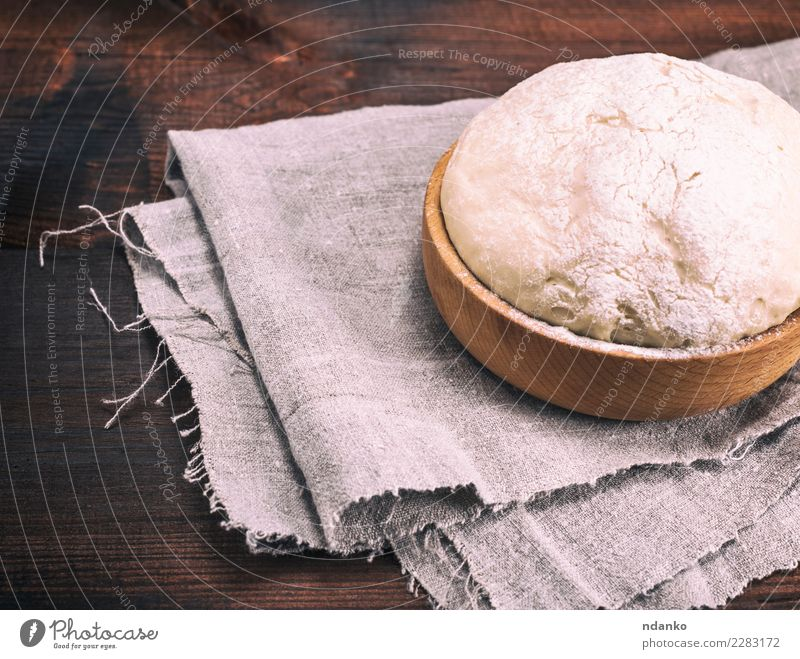 yeast dough in a wooden bowl Dough Baked goods Bread Bowl Table Kitchen Wood Fresh Natural Above Brown White Yeast background Preparation food healthy