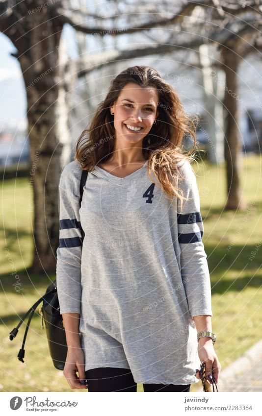 Smiling woman with casual clothes in urban background Shopping Elegant Beautiful Human being Feminine Young woman Youth (Young adults) Woman Adults 1