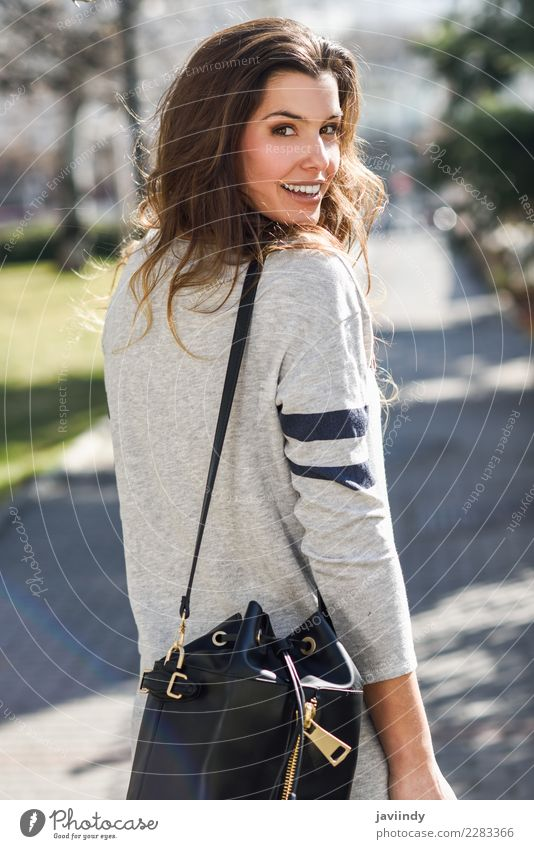 Portrait of beautiful woman smiling in the street Shopping Elegant Beautiful Human being Young woman Youth (Young adults) Woman Adults 1 18 - 30 years Street