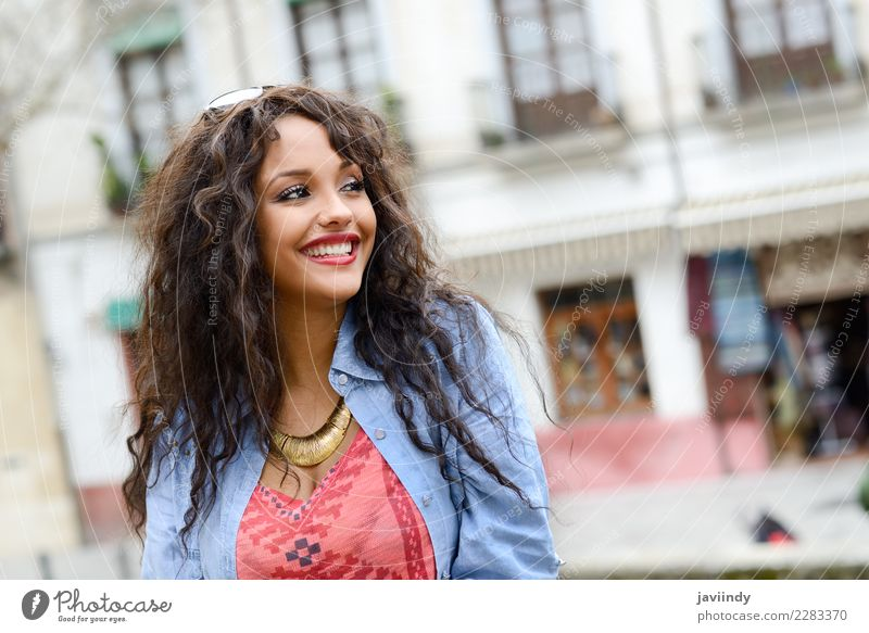 Mixed woman in urban background wearing casual clothes Woman Human being Youth (Young adults) Young woman Beautiful Joy 18 - 30 years Black Street Adults