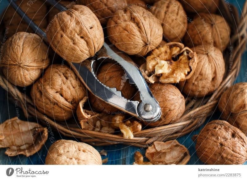 Fresh walnuts with a nutcracker Old Blue Natural Group Gray Brown Nutrition Table Crack & Rip & Tear Vegetarian diet Rustic Vegan diet Raw Ingredients Snack