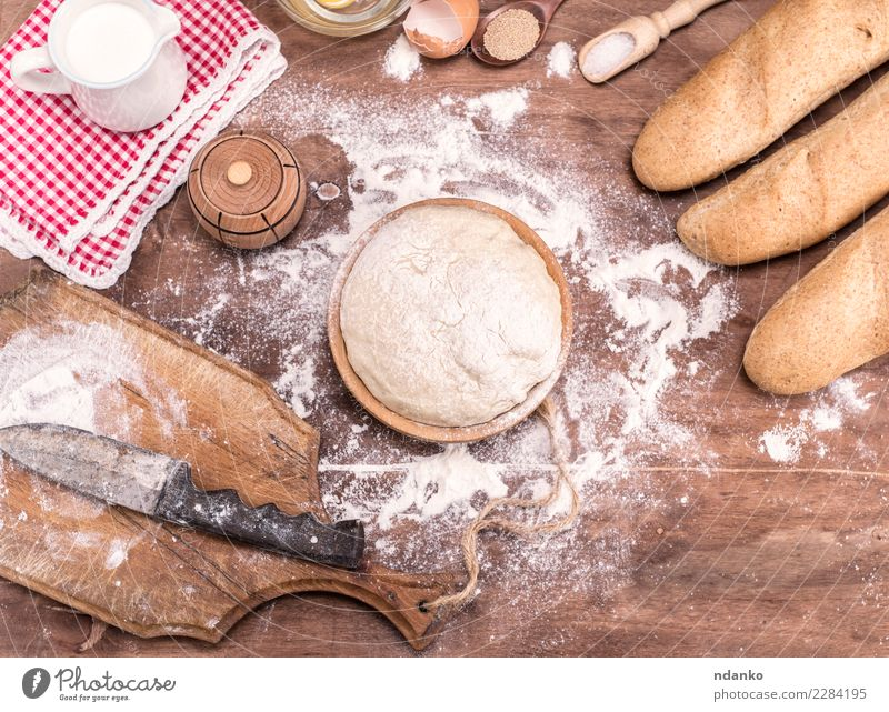 wheat yeast dough for bread Dough Baked goods Bread Roll Bowl Table Kitchen Wood Fresh Natural Brown White Yeast background Preparation food healthy Ingredients