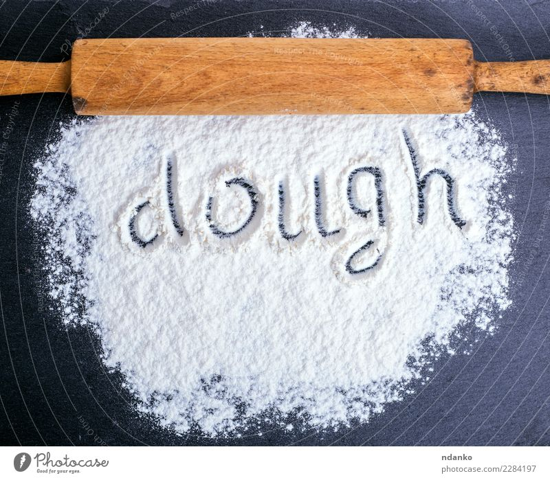 scattered white wheat flour Dough Baked goods Bread Nutrition Table Kitchen Wood Eating Natural Black White Rolling pin Flour cook Raw food Consistency Bakery