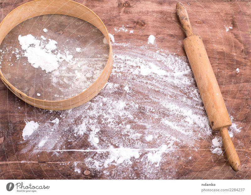 flour sprinkled on a brown wooden table Dough Baked goods Bread Table Kitchen Sieve Wood Retro Brown White Wheat Cooking Culinary Baking space board Consistency