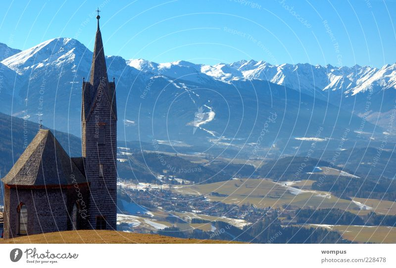 Winterende in Tirol Landscape Sky Cloudless sky Beautiful weather Alps Mountain Snowcapped peak Church Blue Brown Green White Tourism Colour photo Exterior shot