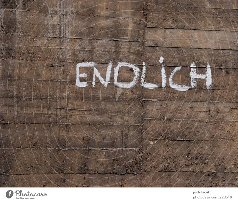 unlasting Wall (barrier) Wall (building) Concrete Characters Graffiti Line Stripe Old Authentic Dark Simple Brown Curiosity Fear of the future Impatience