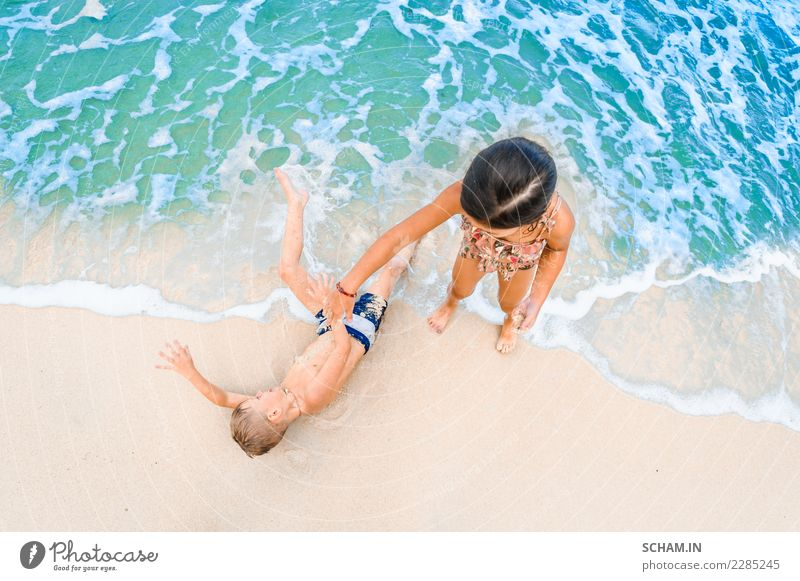 Cute boy and girl having fun on the sunny tropical beach Child Human being Nature Summer Beautiful Water Landscape Joy Girl Life Lifestyle Feminine Boy (child)