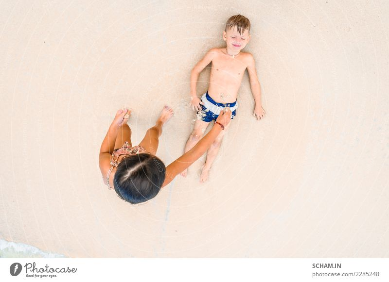 Cute boy and girl on the beach. View from above Child Human being Summer Landscape Joy Girl Beach Lifestyle Laughter Boy (child) Freedom Sand Above Lie Infancy