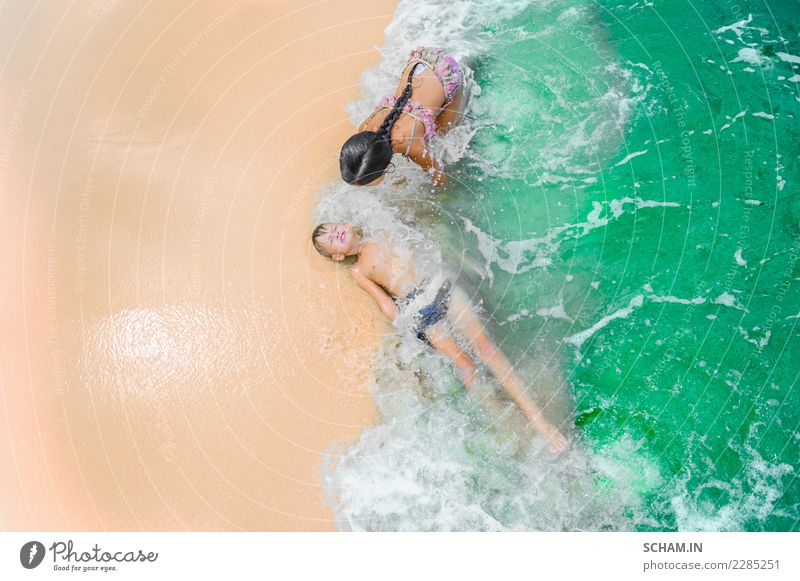 Cute kids having fun on the sunny tropical beach Child Human being Summer Beautiful Green Water Landscape Sun Ocean Joy Girl Beach Life Lifestyle Love Feminine