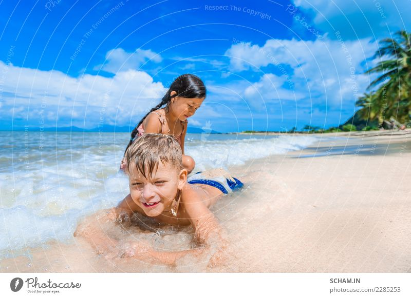 Cute kids having fun on the sunny tropical beach. Lifestyle Joy Freedom Summer Island Child Human being Girl Boy (child) Infancy 2 3 - 8 years Youth culture
