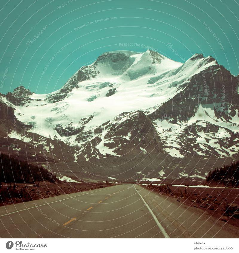 Loneliness Far-off places Street Landscape Mountain Asphalt Peak Highway Canada Glacier Cloudless sky Snowcapped peak Untouched Lane markings Sky Emotions