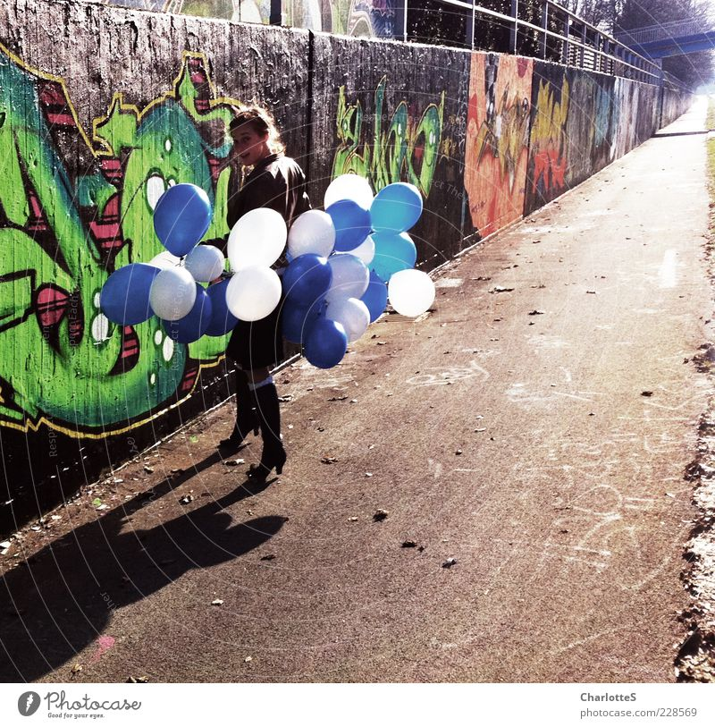 Wall (building) Graffiti Playing Movement Lanes & trails Stone Wall (barrier) Feasts & Celebrations Going Facade Concrete Clothing Balloon Observe Asphalt Sign