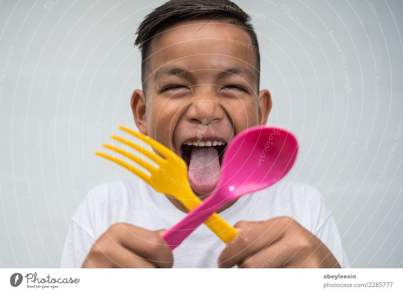 young asian boy with foek and spoon Woman Human being Man Beautiful Green White Hand Face Eating Adults Life Lifestyle Natural Happy Leisure and hobbies