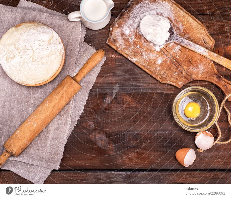 yeast dough in a wooden bowl Dough Baked goods Bread Bowl Spoon Table Kitchen Wood Fresh Natural Brown White Rolling pin Yeast background Preparation food