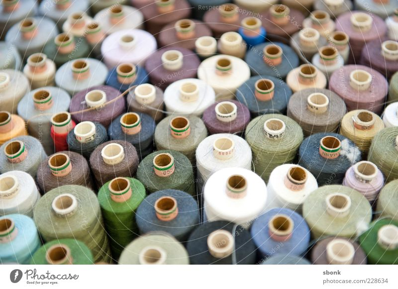 sewable Fashion Clothing Sewing thread Bobbin Design Colour photo Interior shot Shallow depth of field Deserted Blur Many Multicoloured Side by side Arrange