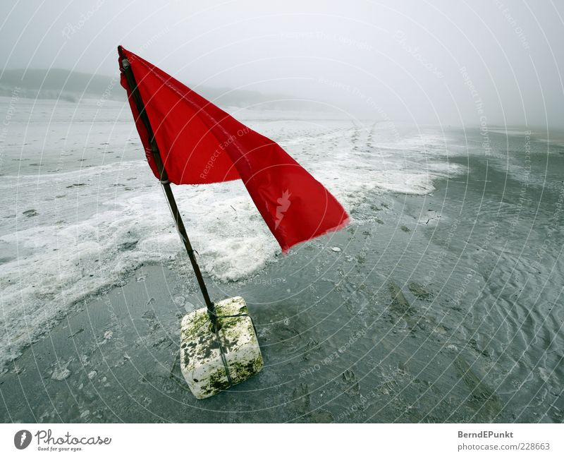 Water Red Beach Winter Loneliness Far-off places Sand Coast Waves Wind Fog Island Threat Uniqueness Flag North Sea