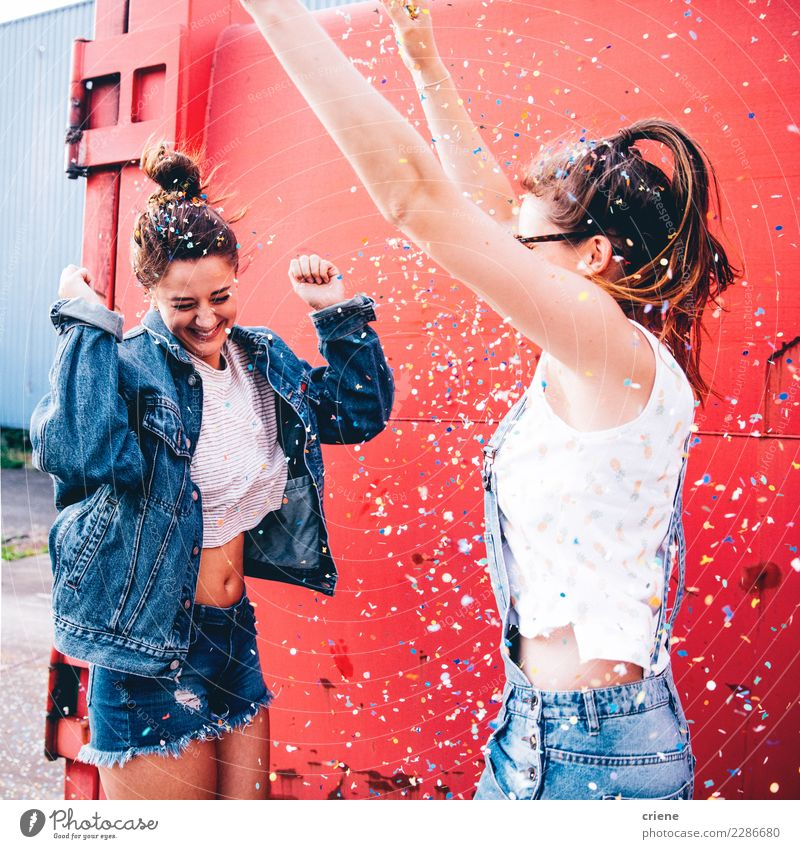 Friends celebrating with confetti Woman Human being Youth (Young adults) Young woman Joy 18 - 30 years Adults Lifestyle Feminine Happy Feasts & Celebrations