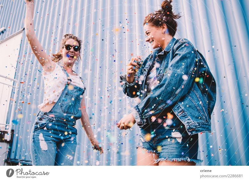 Young adult best friends cheering with confetti on party Joy Happy Night life Entertainment Party Event Music Club Disco Feasts & Celebrations Dance