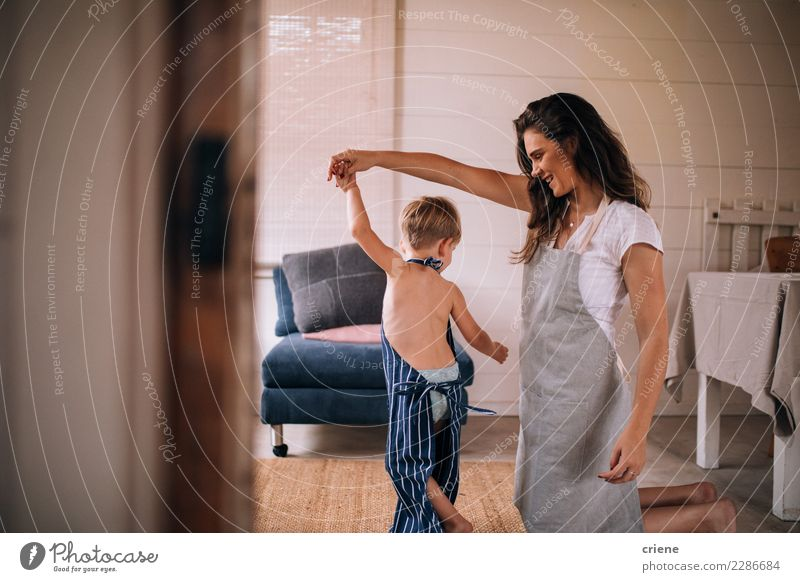 Mother dancing with toddler son in living room Child Human being Joy Adults Family & Relations Boy (child) Happy Together Dance Kitchen Relationship Toddler