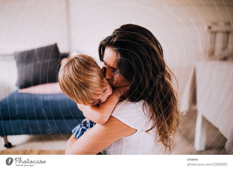 Mother and Son cuddling at home Happy Child Human being Toddler Boy (child) Adults Family & Relations Infancy Kissing Love Together Cute Emotions Relationship