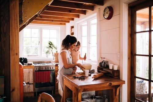 Caucasian mother and son baking cookies in kitchen together Lifestyle Leisure and hobbies Winter Kitchen Parenting Child Human being Toddler Boy (child) Parents