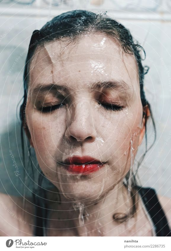 Portrait of a young woman with water running down her face Lifestyle Beautiful Personal hygiene Skin Face Senses Relaxation Spa Human being Feminine Young woman