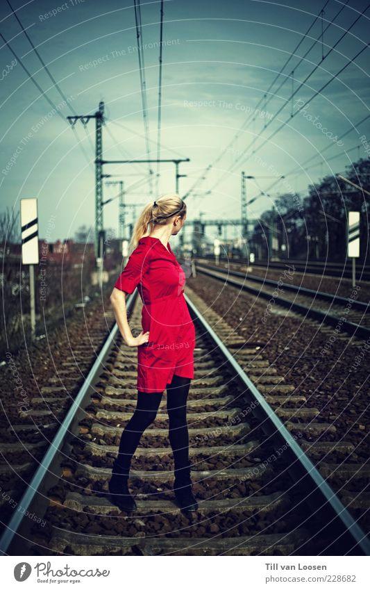 Clouds Environment Blonde Signs and labeling Dangerous Posture Dress Railroad tracks Electricity pylon Braids Overhead line Rail transport