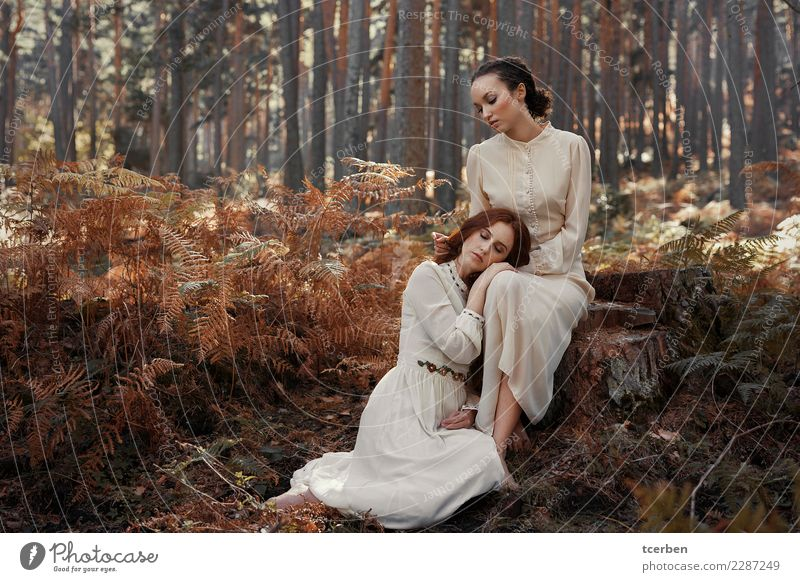 Portrait of two women sitting and hugging in an autumnal forest Human being Youth (Young adults) Old Young woman Beautiful White Forest 18 - 30 years Adults