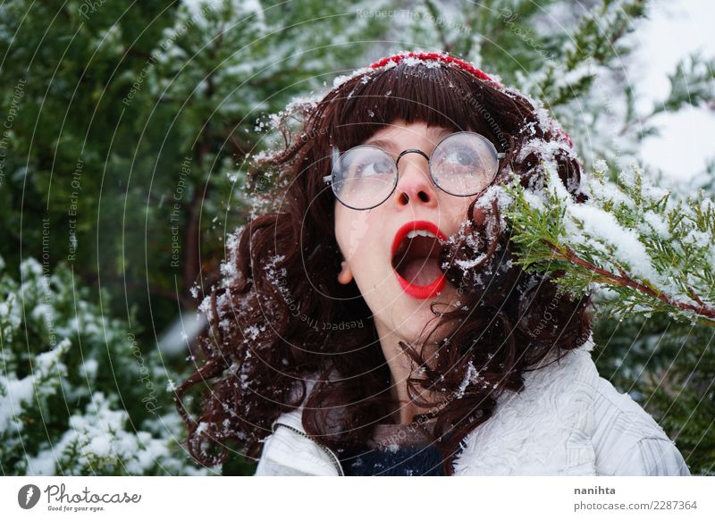 Young woman surprised in a snowy day Lifestyle Exotic Joy Hair and hairstyles Skin Face Vacation & Travel Freedom Expedition Winter vacation Human being