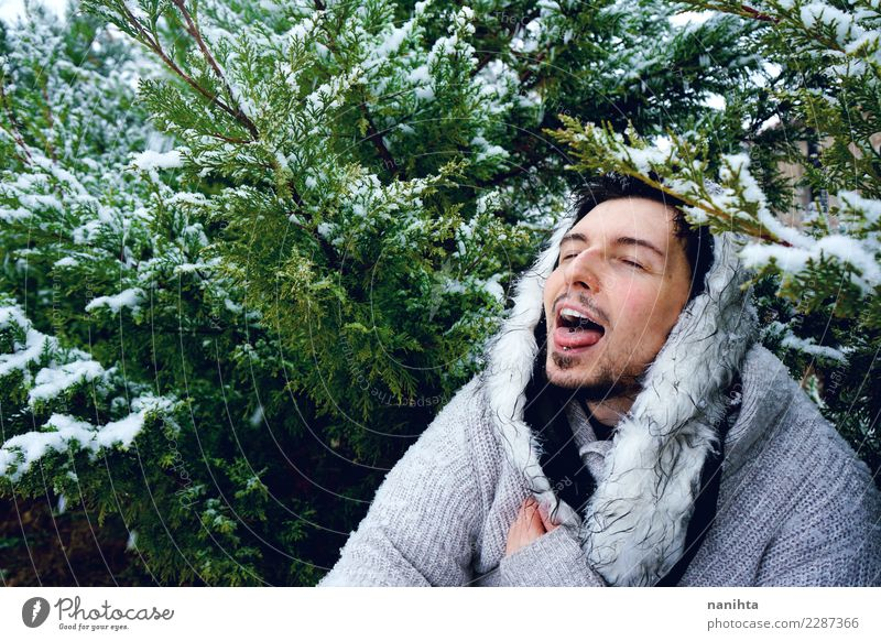 Young man enjoying the snow in a winter day Lifestyle Style Joy Wellness Well-being Winter Snow Winter vacation Human being Masculine Youth (Young adults) Man