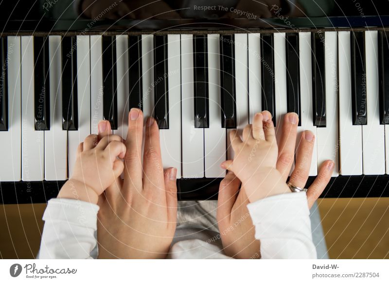Mother and child playing the piano Family Child Parenting at the same time in common Love Responsibility upbringing Piano Music Musician Musical instrument