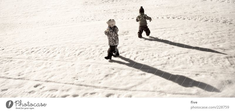 Human being Child Joy Snow Playing Boy (child) Friendship Funny Infancy Together Leisure and hobbies Going Walking Toddler Beautiful weather Snow track