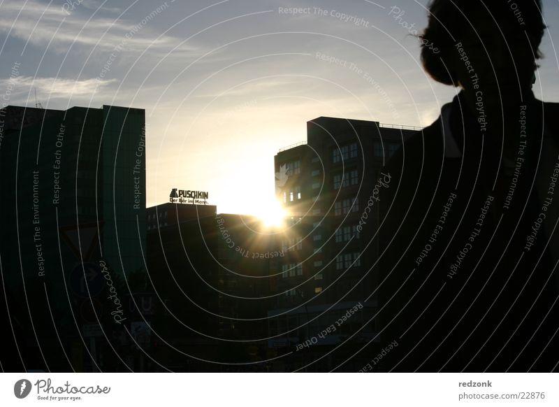 Last beam Sunset Woman Radiation Silhouette Alexanderplatz Human being Evening Shadow Pushkin Berlin Skyline