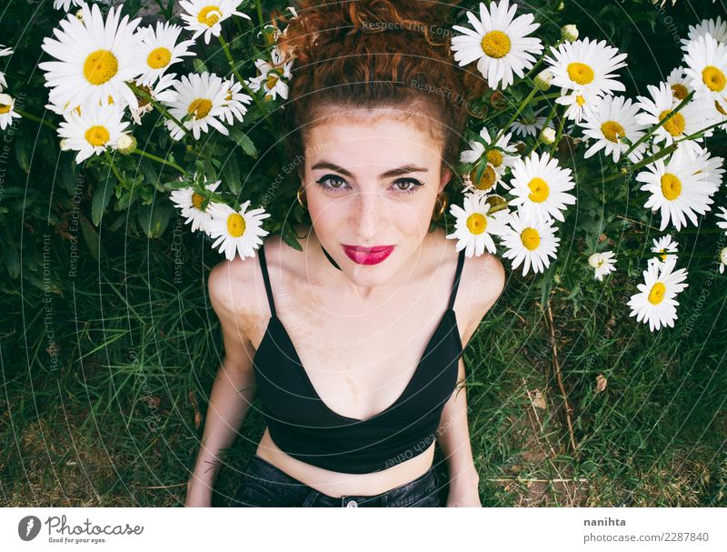 Young woman posing in a garden of daisies Lifestyle Elegant Style Beautiful Hair and hairstyles Wellness Harmonious Senses Human being Feminine