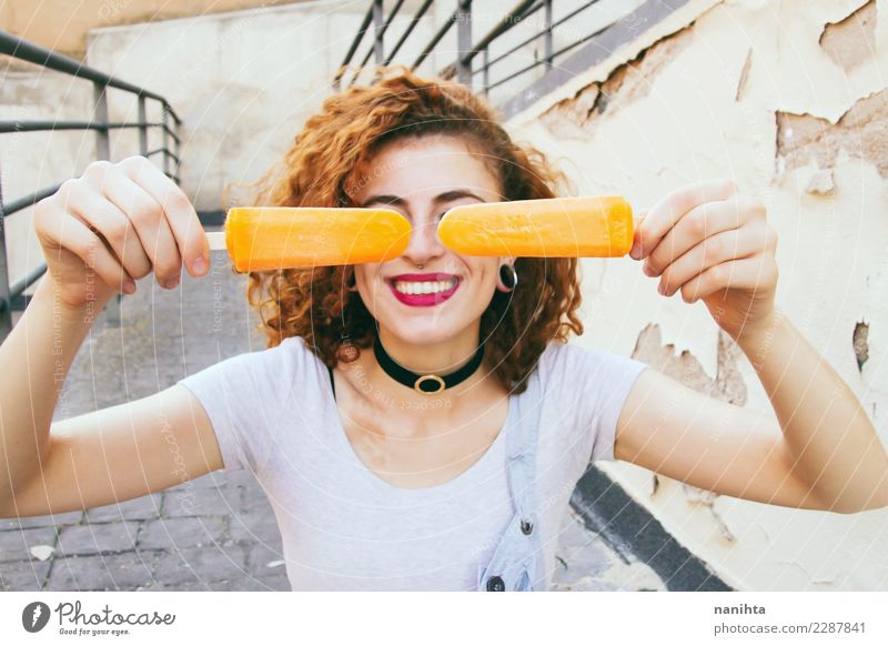 Young happy woman holding two orange ice creams Human being Vacation & Travel Youth (Young adults) Young woman Summer Town Beautiful Joy 18 - 30 years Adults