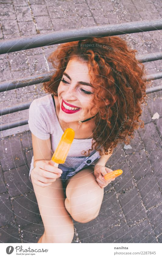 Young happy woman eating ice creams Food Ice cream Eating Lifestyle Style Joy Hair and hairstyles Face Summer Summer vacation Human being Feminine Young woman