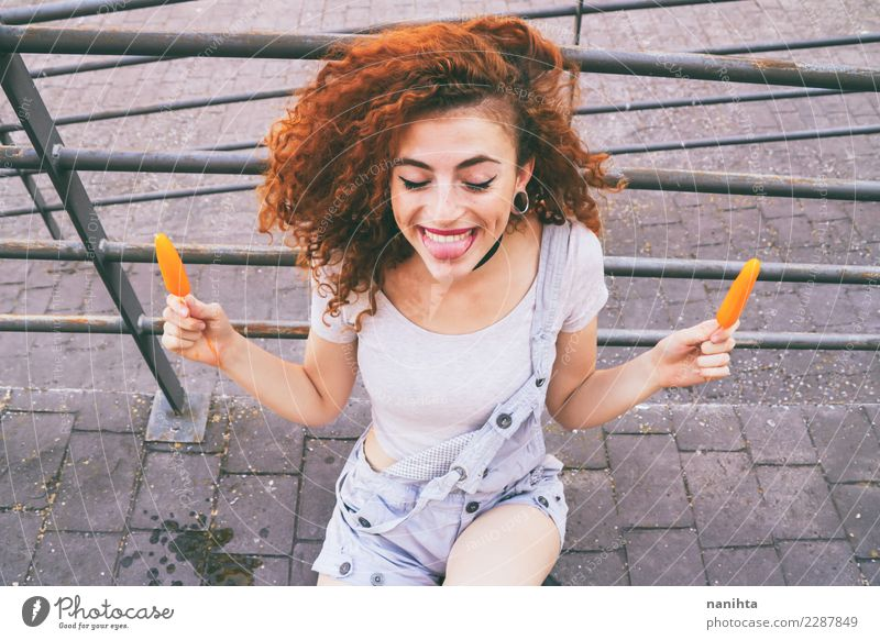 young happy and redhead woman holding two ice creams Human being Youth (Young adults) Young woman Summer Beautiful Joy 18 - 30 years Adults Eating Life
