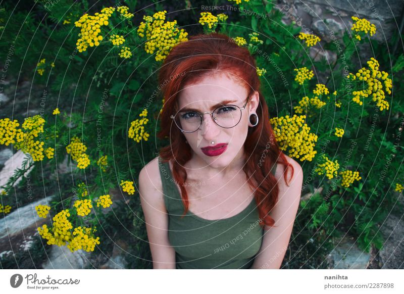 Young woman with a disgust expression Human being Nature Youth (Young adults) Plant Beautiful Green Flower 18 - 30 years Face Adults Lifestyle Environment