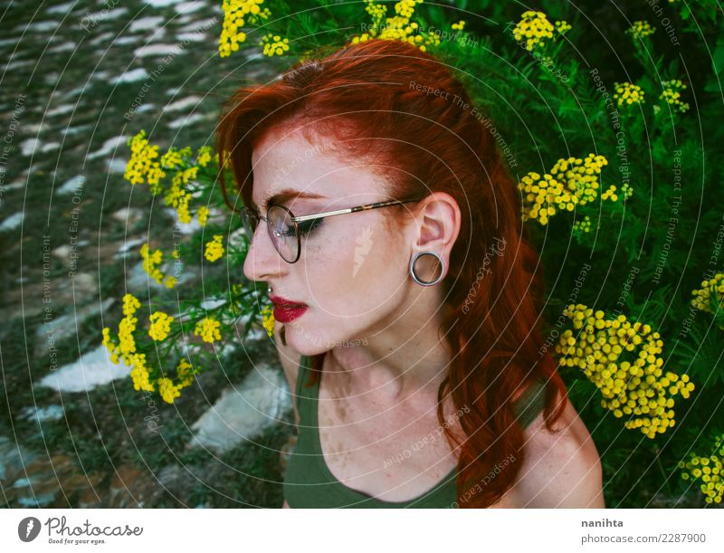 Profile of a young and sad redhead woman Human being Nature Youth (Young adults) Young woman Plant Beautiful Green Flower Red Loneliness 18 - 30 years Adults